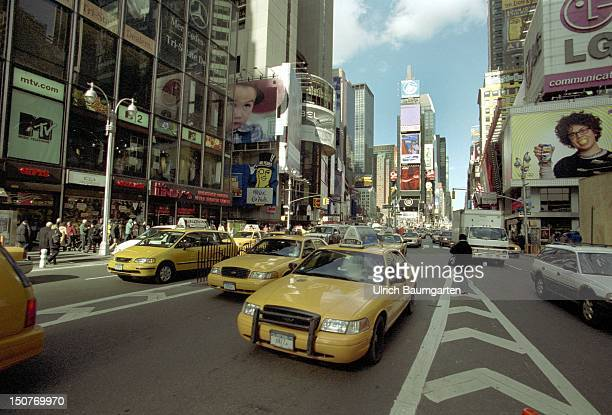 Road traffic with cabs at the Times Square