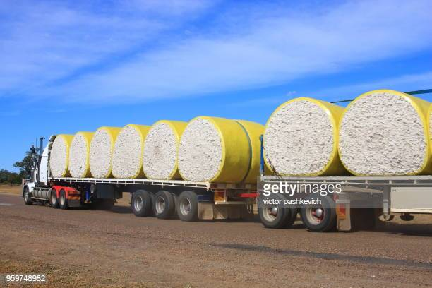 road train carrying cotton bales - cotton gin stock photos and pictures