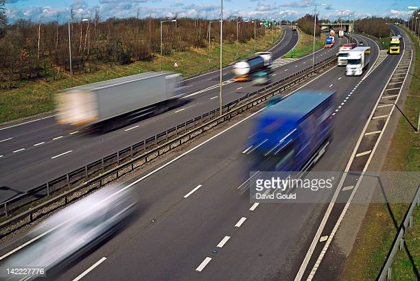 Road transport vehicles blurred with speed