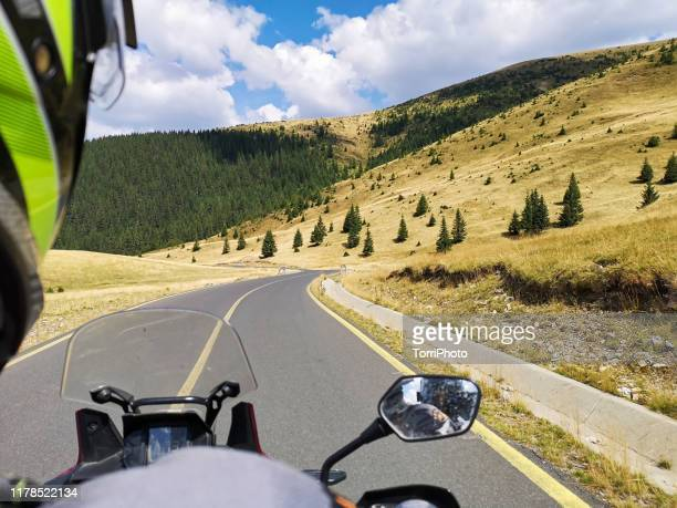 road trip by the motorcycle. shot on the move - handlebar stock pictures, royalty-free photos & images