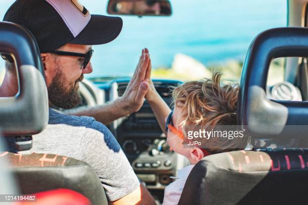 road trip. father and son travelling together by car - vacations stock pictures, royalty-free photos & images