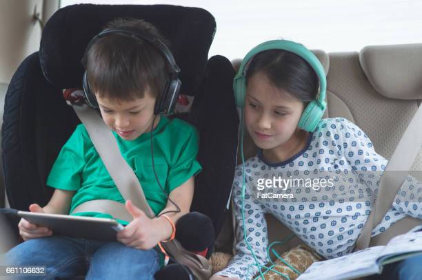road trip! - family inside car stock photos and pictures