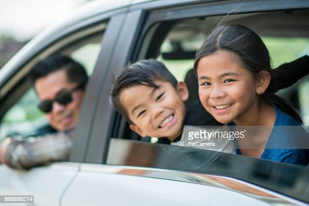road trip - happy family in car stock photos and pictures