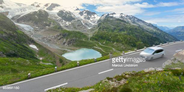 road trip through the alps - mountain pass stock pictures, royalty-free photos & images