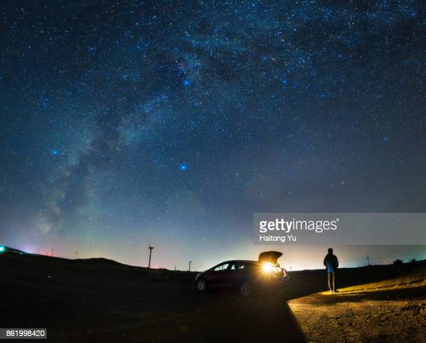 road trip under the milky way. - moody sky stock pictures, royalty-free photos & images