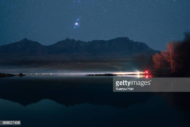 road trip under the starry sky - tail light stock pictures, royalty-free photos & images