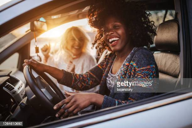 road trip with best friend - singing stock pictures, royalty-free photos & images