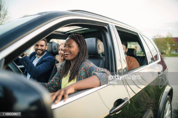 road trip with best friends - four people in car stock pictures, royalty-free photos & images