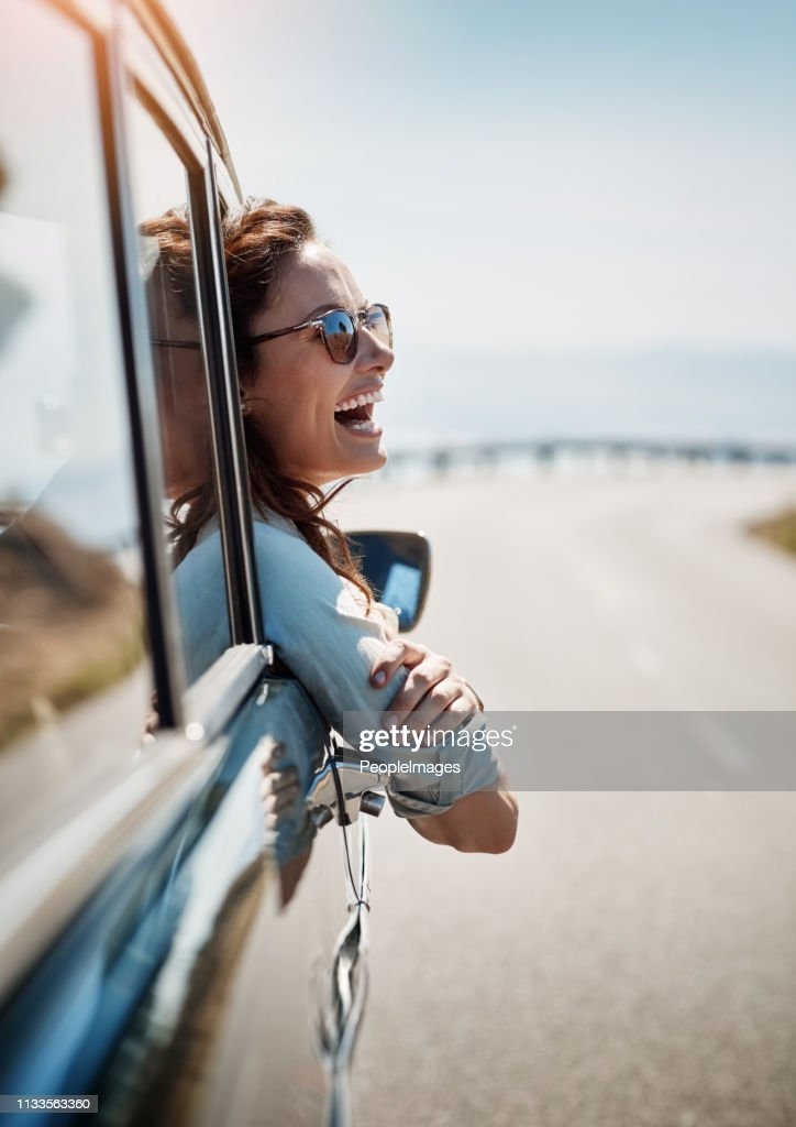 Road trips put me in a happy mood : Stock Photo