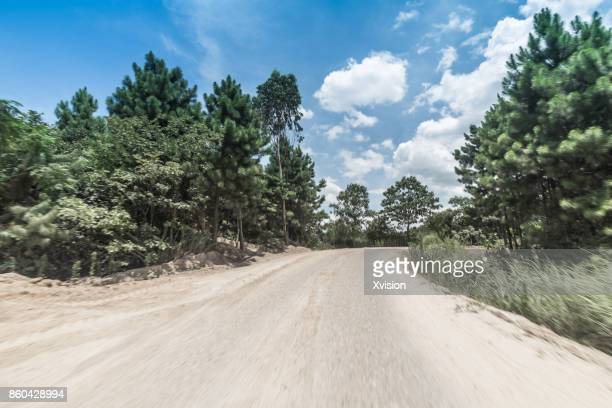 Road under blue sky in rural