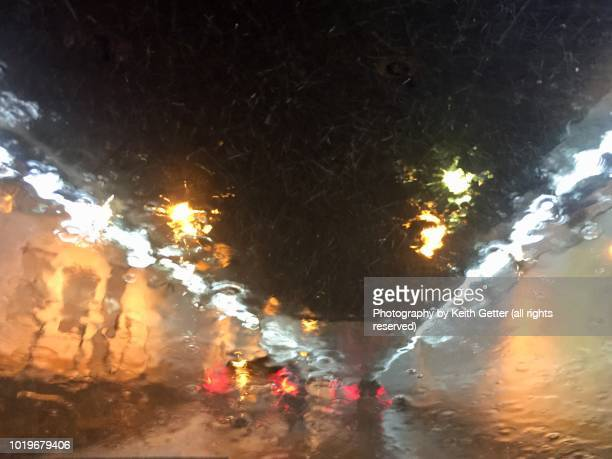 road view entering the holland tunnel during a torrential rainstorm - torrential rain stock pictures, royalty-free photos & images