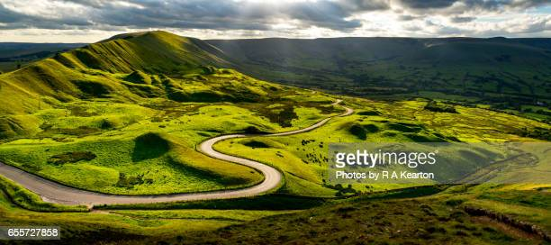 Road winding through green hills