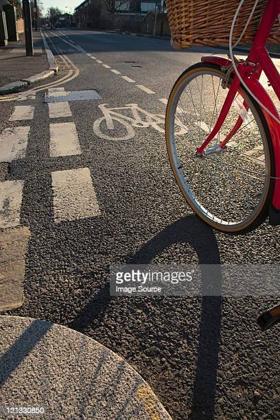 road with cycle path and bicycle - bicycle lane stock pictures, royalty-free photos & images