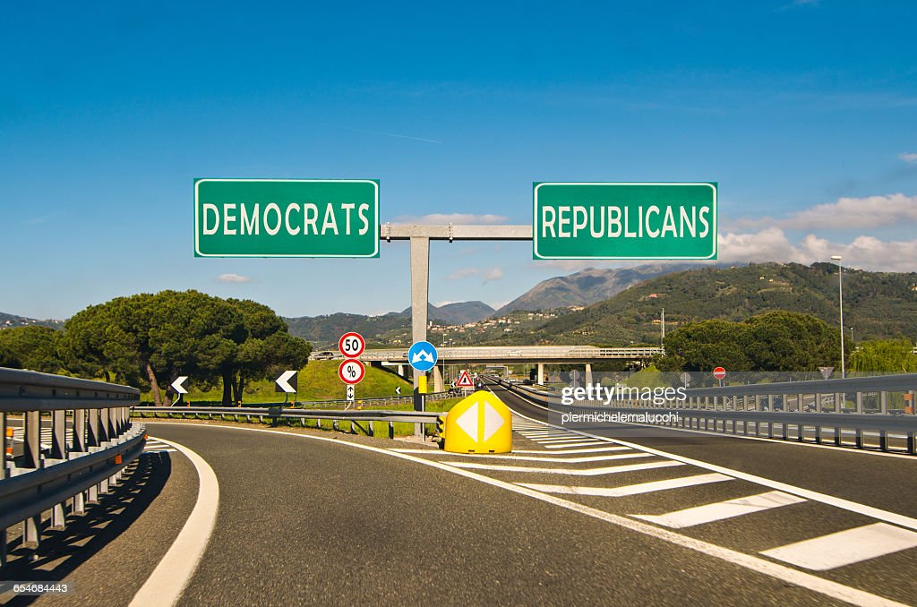 Road with democrats and republicans road signs at junction : Stock Photo