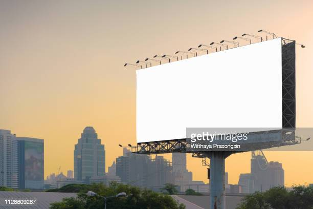 road with lanterns and large blank billboard at evening in city : bangkok : thailand - outdoors - fotografias e filmes do acervo
