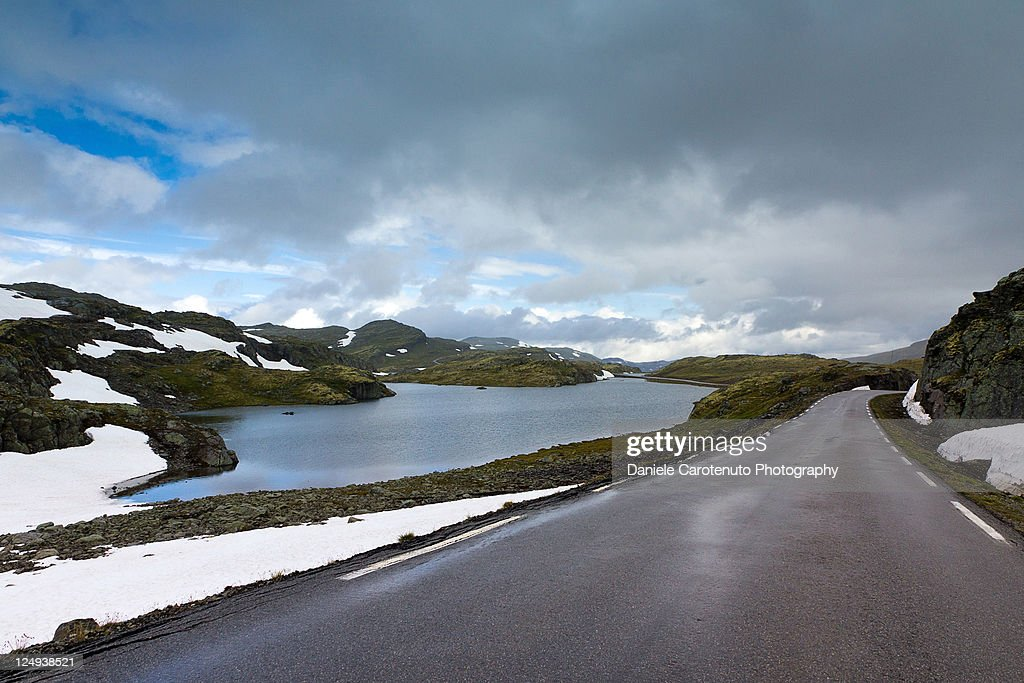 Road with snow mountains on both side : Stock Photo
