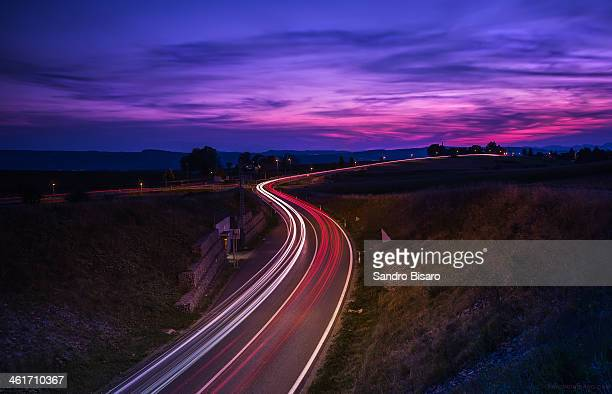 Road with traffic trails at sunset