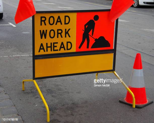 'road work ahead' sign in a city street - road construction stock pictures, royalty-free photos & images