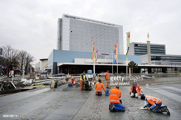 Road work is undertaken in front of the World Forum Convention Center in The Hague, the Netherlands, on February 10, 2014. On March 24 and 25 the...
