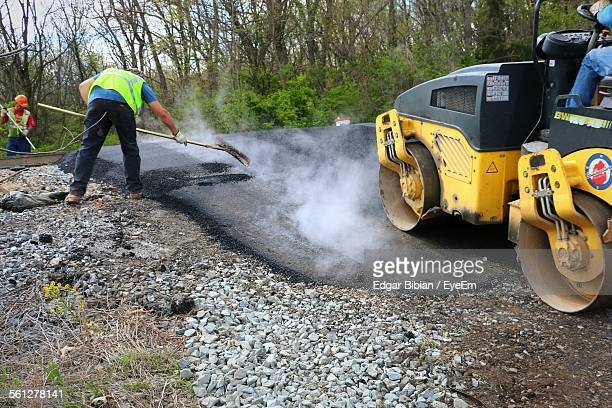Road Workers Making Asphalt On Road