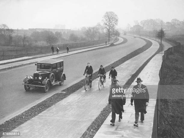 Road works seperated traffic lanes for cars bikes and pedestrians in Berlin Keystone View Company Vintage property of Ullstein Bild