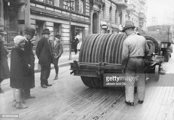 Road works with the help of construction machines at Eisenacher Strasse in Berlin keying the surface Keystone View Company Vintage property of...