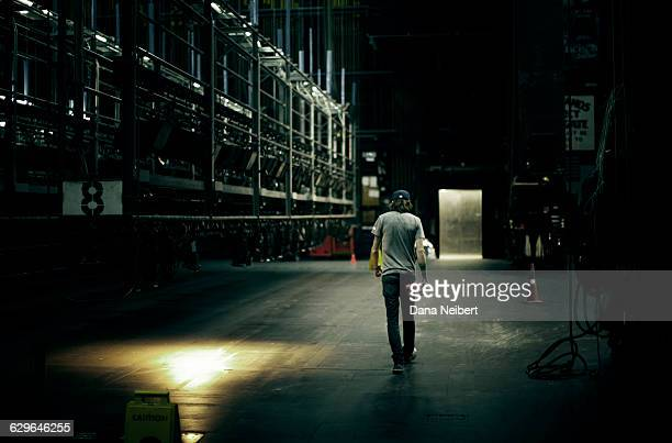 A roadie walks back stage