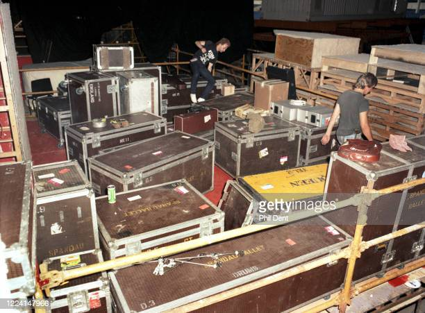 Roadies amongst rows of flight cases belonging to the bands Spandau Ballet and Queen backstage at Live Aid, Wembley Stadium, London, 13th July 1985.