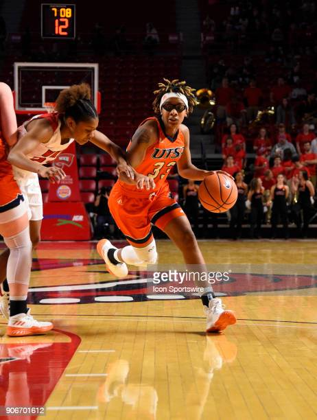 Roadrunners guard Barbara Benson dribbles past Western Kentucky Lady Toppers guard/forward Kayla Smith during the third period during the women's...
