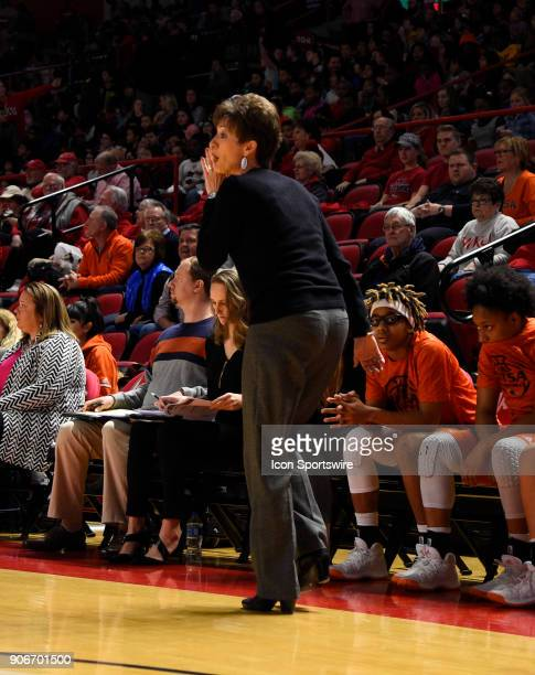 Roadrunners head coach Kristen Holt tells her players to run a play during the fourth period during the women's college basketball game between the...