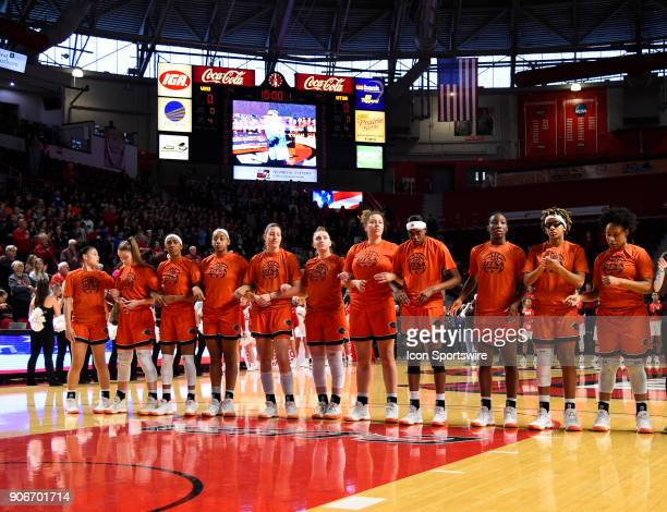 Roadrunners stand with arm interlocked as the stand for the National Anthem during the first period during the women's college basketball game...
