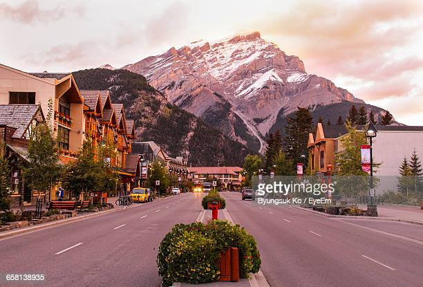 roads against canadian rockies - canadian rockies stock pictures, royalty-free photos & images