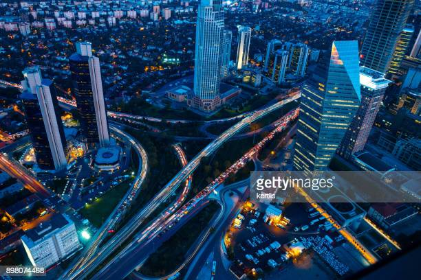 roads and skyscrapers of istanbul at night - istanbul stock photos and pictures