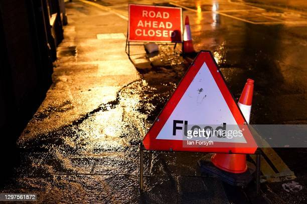 Roads are closed alongside the River Ouse in York following flooding as rain and recent melting snow raise river levels on January 21, 2021 in York,...