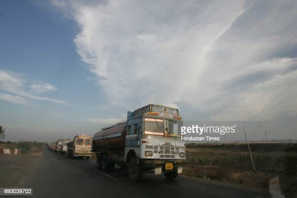 Roads Highway Trucks Karanji Khurd village Navapur in Nandurbar District of North Maharashtra on Tuesday