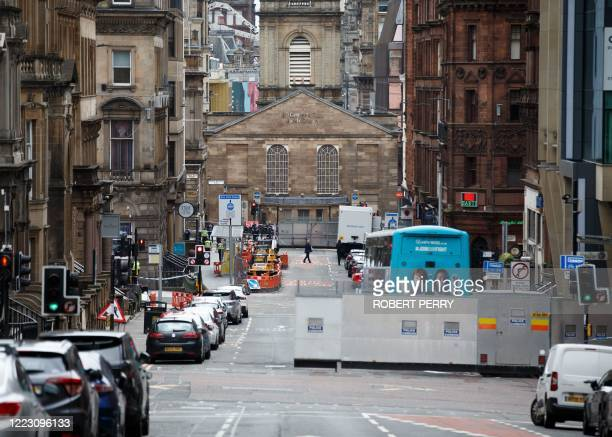 Roads remain closed and a police cordon in place in central Glasgow on June 27 2020 following a stabbing incident at the Park Inn hotel the previous...