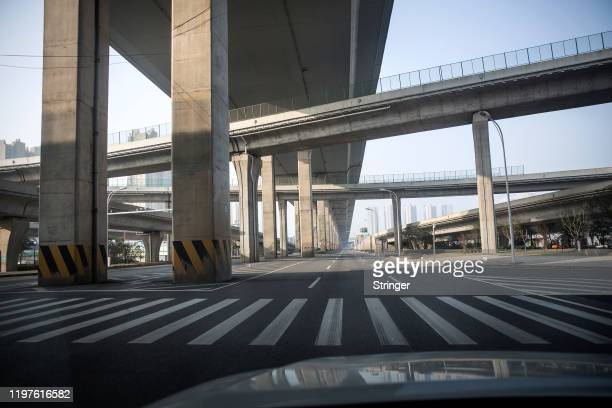 Roads remain empty because of travel restrictions on January 30 2020 in Wuhan China The number of cases of a deadly new coronavirus rose to over 7000...