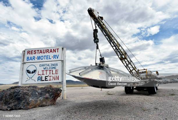 Roadside artwork featuring a tow truck and a flying saucer is displayed at the Little A'le' Inn restaurant and gift shop on July 22 2019 in Rachel...