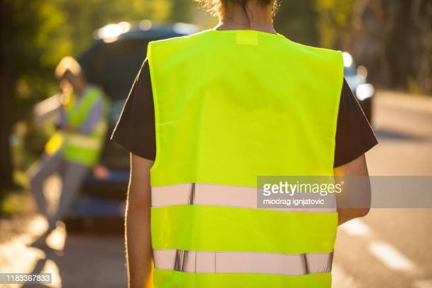 roadside assistance is here - reflective clothing stock pictures, royalty-free photos & images