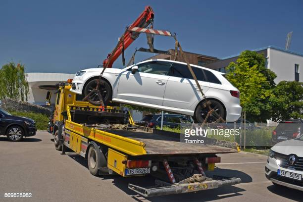 roadside assistance truck at work - tow truck stock photos and pictures