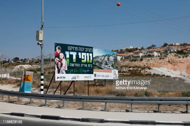 Roadside billboards advertising newly constructed apartments for sale in settlements are seen near the West Bank Settlement of Nili on July 31, 2019....