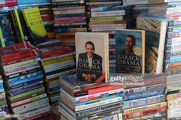 A roadside bookstore displays books on US President Barack Obama in Mumbai on January 21 2013 Barack Obama will on January 21 join select political...