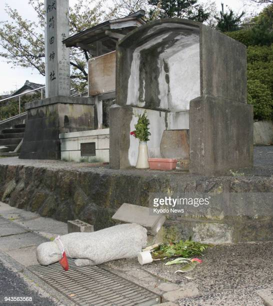 A roadside Buddhist statue is seen collapsed in Oda Shimane Prefecture after a magnitude 61 earthquake hit the western Japanese prefecture on the...