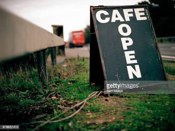 A roadside cafe sign advertising Donas Cafe along the busy A12 trunk road on the 20th October 2009 in Stratford St Mary in the United Kingdom