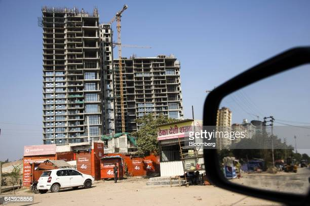 A roadside liquor store right stands near buildings under construction along a highway in Gurgaon Haryana India on Monday Feb 20 2017 As India the...