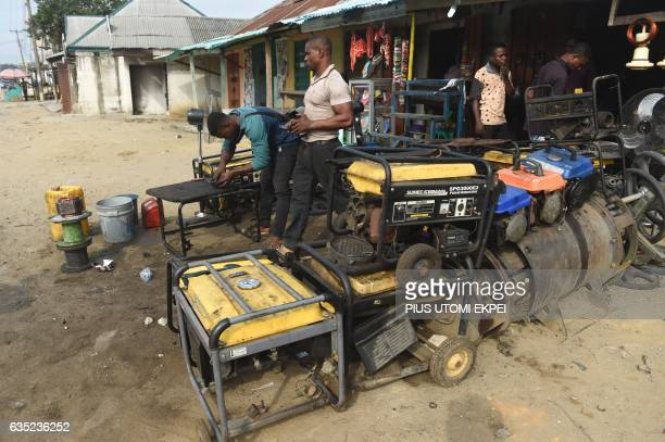 A roadside mechanic repairs electricity generators that are believed to contribute to the environmental pollution in Port Harcourt city Rivers State...