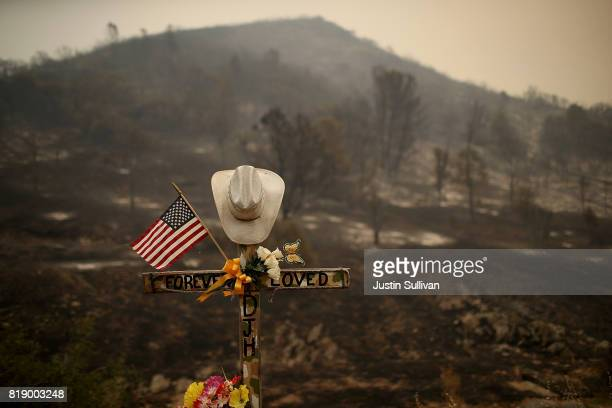 A roadside memorial stands next to an area burned by the Detwiler Fire on July 19 2017 in Mariposa California More than 1400 firefighters are...