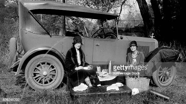 Roadside picnic along the car, ca. 1920