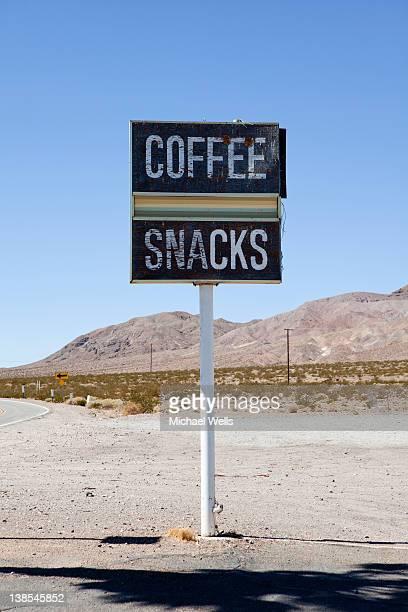 roadside sign advertising coffee and snacks, baker, california - カリフォルニア州ベーカー ストックフォトと画像