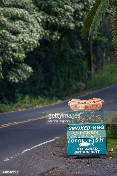 Roadside sign advertising variety of meals.